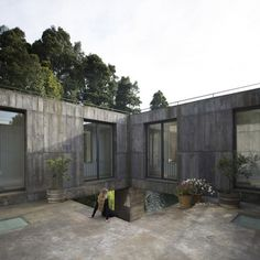 """This """"monolithic prism of concrete"""" nestles into the hillside beside a Chilean lagoon"""