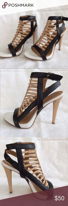"Calvin Klein tan, black and white cage heels Seriously sexy cage heel sandals by Calvin Klein. Tri-color leather upper. I LOVE these shoes but I have to cross a busy street many times a day at work so these won't work for me ☹️  Small round scuff on front of left shoe as pictured.  Side buckle.  Size 8 (but not shown on shoe). Heel height 4""  Besides scuff and bottom of shoe, these look brand new!!  Make an offer as someone should really get to enjoy these! 😎 Calvin Klein Shoes Heels"