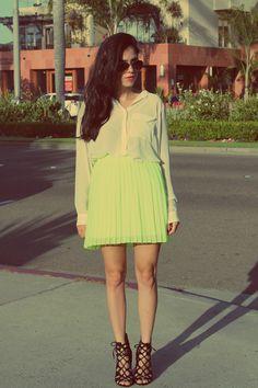 "Lucia of ""Around Lucia"" wearing UO's neon pleated skirt #urbanoutfitters #neon #pleats"