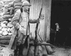 WWI; French soldier with a Lebel rifle modified with a spotlight.