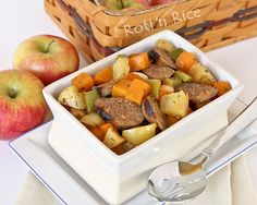 Use the seasonal abundance of apples and squash in this Roasted Apples, Squash, and Sausage dish sweetened with a little maple syrup. It's delicious! #sidedish #sausage #apples #squash