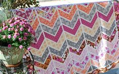 Chevron quilt - she even shares how to make your own.