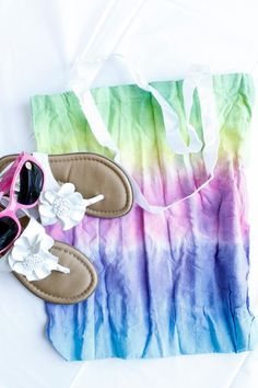 This tie dye canvas tote is a fun craft that's perfect for summer activities. My girls were so excited with the idea of making a tie-dye craft that they