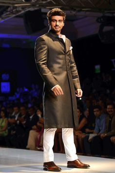 Bollywood actors Anil Kapoor, Arjun Kapoor and Frieda Pinto took to the runway on Day 3 of the ongoing Delhi Couture Week (DCW) for Masaba Gupta's Satya Paul couture collection and Varun Bahl respectively. Engagement Dress For Groom, Wedding Outfits For Groom, Wedding Wear, Mens Sherwani, Wedding Sherwani, Indian Groom Wear, Indian Wear, Look Fashion, Indian Fashion