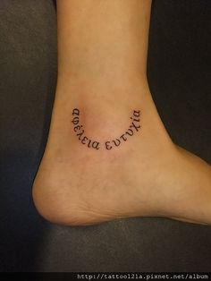 Ankle tattoo.