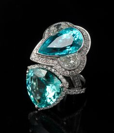 Paraiba Tourmaline rings with diamonds, exclusively from TAYMA Fine Jewellery.