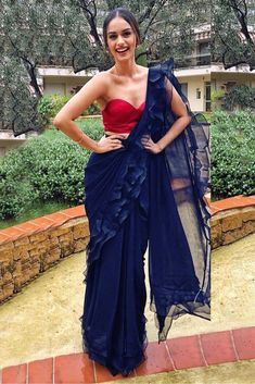 60 GM Georgette Silk Ruffle Saree In Navy Blue Colour Navy Blue Colour 60 GM Georgette Silk Fabric Saree Comes with matching blouse. This Saree Is crafted with Embroidery This Saree Comes with Unstitched Blouse Which Can Be Stitched Up to size Indian Bridal Outfits, Indian Designer Outfits, Indian Dresses, Designer Dresses, Designer Sarees, Saree Draping Styles, Saree Styles, Drape Sarees, Sari Dress