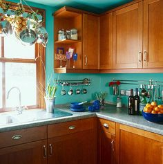 Finally, this turquoise kitchen that's rustic and bright at the same time:
