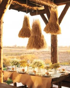 Lugnasad:  The harvest-theme chandeliers are wheat-covered wire baskets. #Lugnasad.