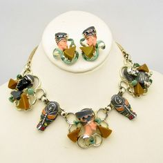 WONDERFUL EGYPTIAN SET! Very rare 1960s Egyptian Revival figural necklace and earrings with enameled figures and Bakelite triangles. Super Special! $725.00