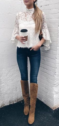White lace bell sleeve top and whiskered blue jeans