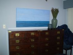 Seascape painting has been moved to the opposite wall -- at least for the time being.