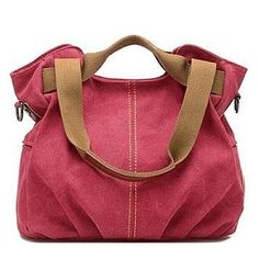"""Everyone needs a durable canvas for summer adventures and beyond! This 100% cotton satchel fits the bill perfectly. The perfect size to accommodate all of your essentials, it also comes with a FREE RFID-blocking wallet case that shields you from identity theft. 14"""" wide x 8"""" deep x 12"""" highInterior has 1 zippered and 2 wall pocketsExterior has 1 zippered and 2 side pocketsTop zipper closureHandles for hand or shoulder carryingIncludes 30"""" strap for crossb..."""