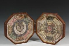 SAILOR'S VALENTINE - 19th c. Folk Art Sailor's Valentine in the original octagonal hinged case of crude walnut stained oak, the delicate valentine itself made up of the typical tiny shells, yellow painted cardboard pa.