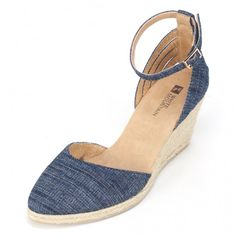 White Mountain Shoes Cisco Denim Wedge Jute bottom, canvas upper, adjustable ankle strap. Multi strap detail at back. For an evening style that exudes glamour and laid-back chic, these wedges make the perfect refined choice.