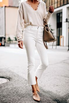 a1fb1c32333aa Woman Wearing Free People Ivory Cashmere Sweater White Lace Bralette  Everlane White Cropped Jeans Vince Blush
