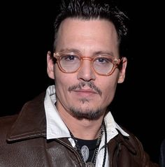 Johny Depp and his clear glasses