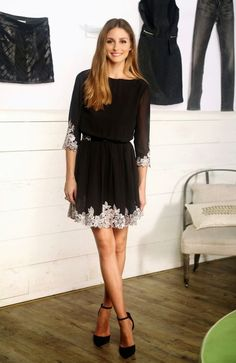 Olivia Palermo - black dress with white lace accents. Straight hair