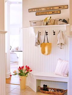 A simple shelf, hooks and a bench. Love the corner cut off of the bench to make easy entry/exit from room. Simple fix.