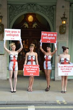 "Bodypainted in St George's flags and holding signs that read, ""Foie Gras Is UnEnglish"" and ""If You ♥ England, Don't Shop at Fortnum's"", PETA UK supporters were outside Fortnum & Mason this evening as the Piccadilly store served a St George's Day meal inside."