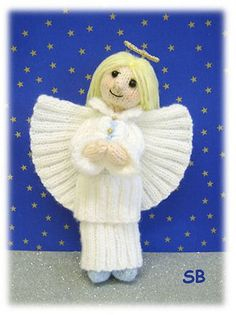 Angelica Christmas Angel - $4.50 - This cute little Christmas Angel stand 9 inches high from her little blue boots, to her sparkling halo. Knitted entirely from DK on 3mm needle. Angelica knits up quickly, from a pattern that is simple and fun with no complicated stitched or shaping. I hope she will become part of your family Christmas for many many years to come :O)