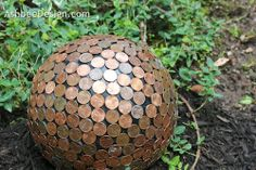 Sculpture---old bowling ball.  Looks cool and repels slugs in the garden.  Use pre-1982 pennies for highest copper content.  Takes approx 300 pennies.