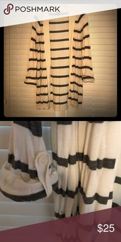 Long buttonless cardigan Long cream cardigan with gray stripes. Buttonless with roll-up sleeves. Gently used Express Sweaters Cardigans