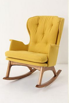 I may not need this for a nursery, but it's mid-century lines are fab. And who doesn't love a nice rocker.