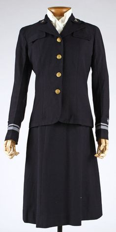 Wool W.A.V.E.S. (U.S. Women's Naval Reserve) uniform, by Mainbocher, American, 1942. Skirt, jacket, and white cotton blouse, worn with navy and white cap.