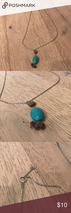 Silver long chain necklace with turquoise pendant Silver long chain necklace with turquoise pendant and brown beads. One size fit all . Great condition. Jewelry Necklaces
