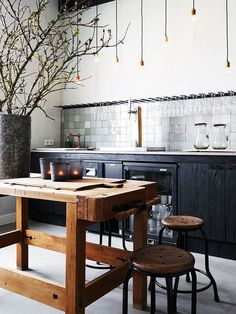 dark lower cabinets + wood island