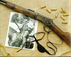 The Winchester 1892 Saddle Ring Carbine with large lever loop used by John Wayne in the film True Grit. Serial #501892. Pictured with .44-40 shells.