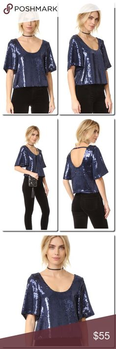 FREE PEOPLE Sequin Tee Sequins shimmer throughout this draped Free People top. A slim strap trims the back. Short sleeves.  Fabric: Sequined gauze. Shell: 100% polyester. Lining: 100% viscose. Hand wash or dry clean. Imported, China.  Measurements Length: 19in / 48cm, from shoulder Measurements from size XS Free People Tops
