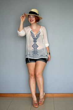 Off-duty, total beauty. A semi-sheer tunic is a natural pick for casual summer fun!
