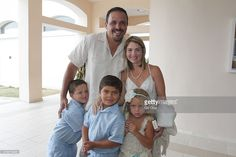 Elliot Figueroa, brother of Chayanne, Maria Valcort and their children attend the baptism of Adamari Lopez's baby at La Sagrada Familia Catholic Church on June 30, 2015 in Humacao, Puerto Rico.
