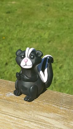 Polymer clay skunk by ARAartisticcreations on Etsy