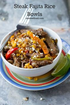 Steak Fajita Rice Bowls are the perfect solution to dinnertime. Grilled steak, sauteed peppers, onions and corn all over fajita seasoned rice. An easy way to use leftovers ohsweetbasil