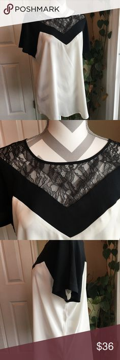 Ann Taylor lace trim top 😻 Beautiful off white and black with lace trim across top!  One button at back.  1 X worn!  No damage!  100% polyester.  Pit to pit measures 22.5; 28 long.  😻 Ann Taylor Tops