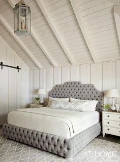 white plank walls + ceiling, gray tufted bed, lattice rug
