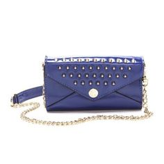 Rebecca Minkoff wallet on a chain in dark purple Wallet on a chain with gold pointed grommets and gold chain. Worn only once. In good condition- a bit misshapen in the front. Rebecca Minkoff Bags
