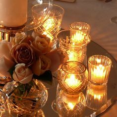 Cut glass vases & tea lights mixed with silver mercury vases for the mantle piece & top table Candle Lanterns, Votive Candles, Reception Decorations, Flower Decorations, Fairy Lights, Tea Lights, Cut Glass Vase, All Of The Lights, Light My Fire