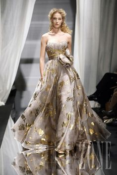 Flowing evening gown with golden accents.