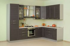 angolo cucina con i colori verde e neri della cucina pareti e pavimenti in…