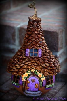 Gourd fairy house with pinecone roof perfect for spring