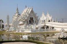 Contemporary Buddhist Temple in Chiang Rai, Thailand All Airlines, Airline Tickets, Buddhist Temple, Barcelona Cathedral, Thailand, Chiang Rai, Drawing Architecture, Mansions, World
