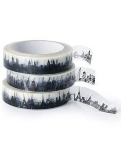 "Skyline Sticky TapeBeautifully drawn line illustration of skylines of Paris, London and NYC - 3 of the best cities in the world. Great for gift wrapping and sealing packages - and will look brilliant and ""snowy"" at Christmas, just on white crisp tissue. The tape measures 66 metres long and 2.5cm wide and is designed by Cecily Vessey. www.nonesuchthings.com"
