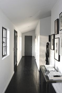 This is the hall that connects the upstairs bedrooms and bath to the great room. We installed and finished a lot of the flooring and thenstained the upstairs floors black using india ink for a true black.