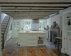Kitchen idea, this one's in the basement.  Or is it a craft room?  It appears they painted the rafter space green then the flat surface white?