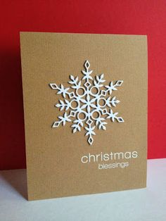 handmade Christmas card ... clean and simple ... kraft base with white ... large and intricate die cut snowflake ... sentiment ... luv it ... Simon Says Stamp