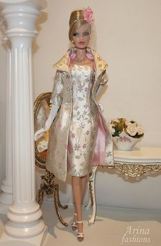 This perfect Valentine's Day outfit fits FR2 and Silkstone Barbie dolls. This elegant ensemble is a combination of pale rose pink, pewter and champagne in matte. The brocade coat has a shawl collar...